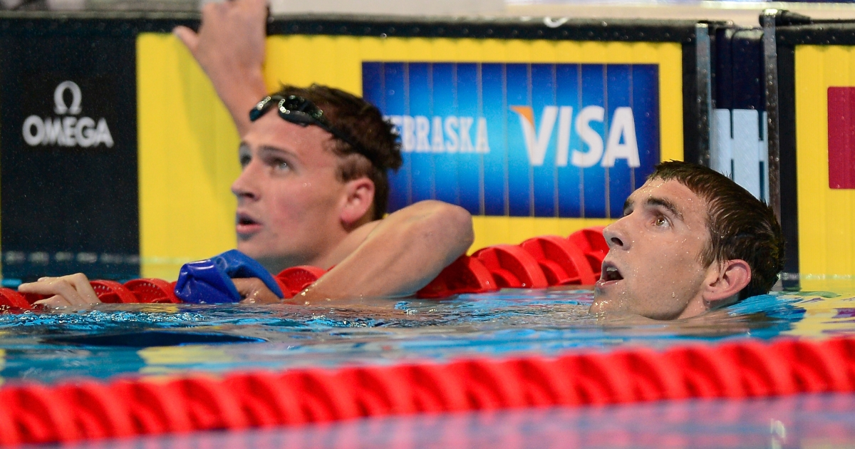 Ryan Lochte (R) and Michael Phelps look on after they competed in the championship final heat of the Men's 400 m Individual Medley during the 2012 U.S. Olympic Swimming Team Trials at CenturyLink Center on June 25, 2012 in Omaha, Nebraska</p>