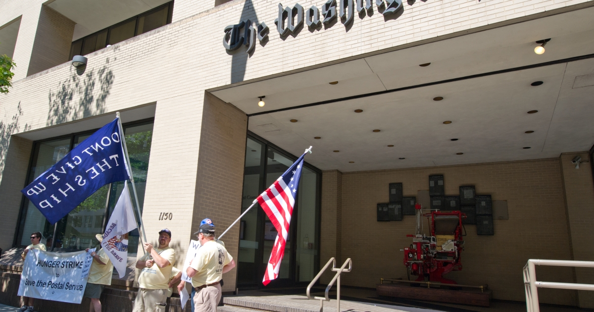 Postal activists demonstrate in front of the Washington Post offices June 27, 2012 in Washington, DC.</p>