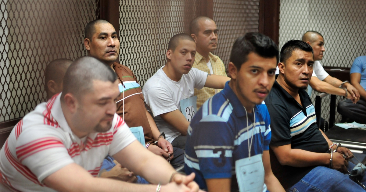 Suspected members of the Zetas drug cartel  from Guatemala and Mexico wait in court for a judgement in Guatemala City on June 27, 2012.</p>