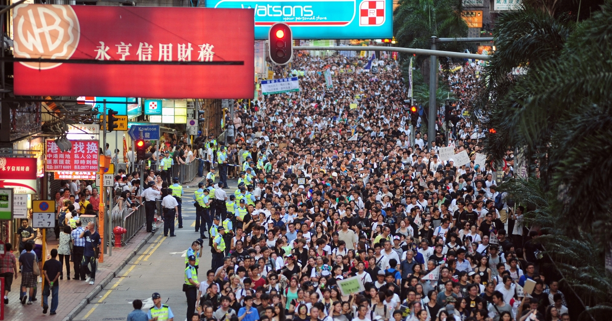 Thousands of protesters take to the streets calling for universal suffrage and chanting slogans against new Hong Kong Chief Executive Leung Chun-ying in Hong Kong on July 1, 2012 only hours after Chinese President Hu Jintao completed his three-day visit to the southern Chinese territory. Hong Kong's new leader Leung Chun-ying, who earlier in the day was sworn in at an inauguration ceremony, took over the city of seven million people amid falling popularity ratings, a series of setbacks and protests over his leadership before he even started his term.</p>