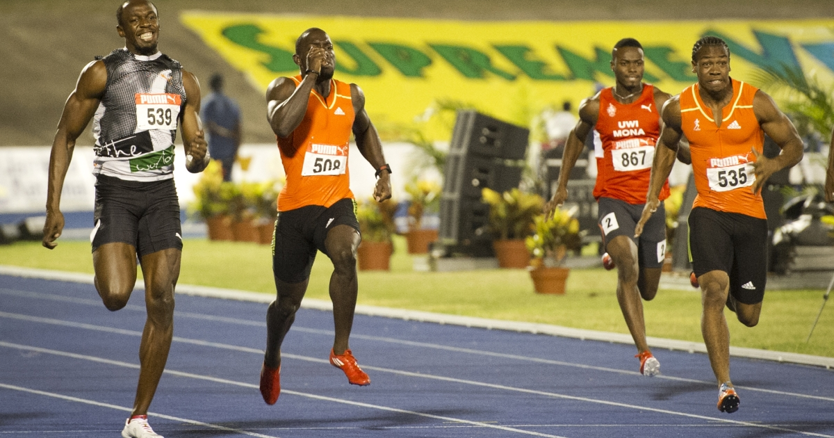 Jamaican sprinters Yohan Blake (R) and Usain Bolt (L) run during the men 200m Dash final of the Jamaican Olympic Athletic Trials at the National Stadium in Kingston, July 01, 2012. Blake stopped the clock at 19.80sec.</p>