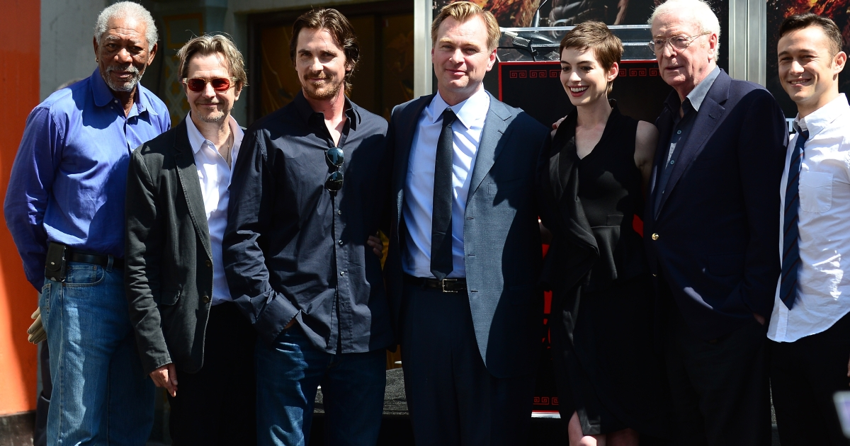 Director Christopher Nolan (C) poses with cast members attending his Hand and Foot print ceremony in front of Grauman's Chinese Theater in Hollywood on July 7, 2012 in California.</p>