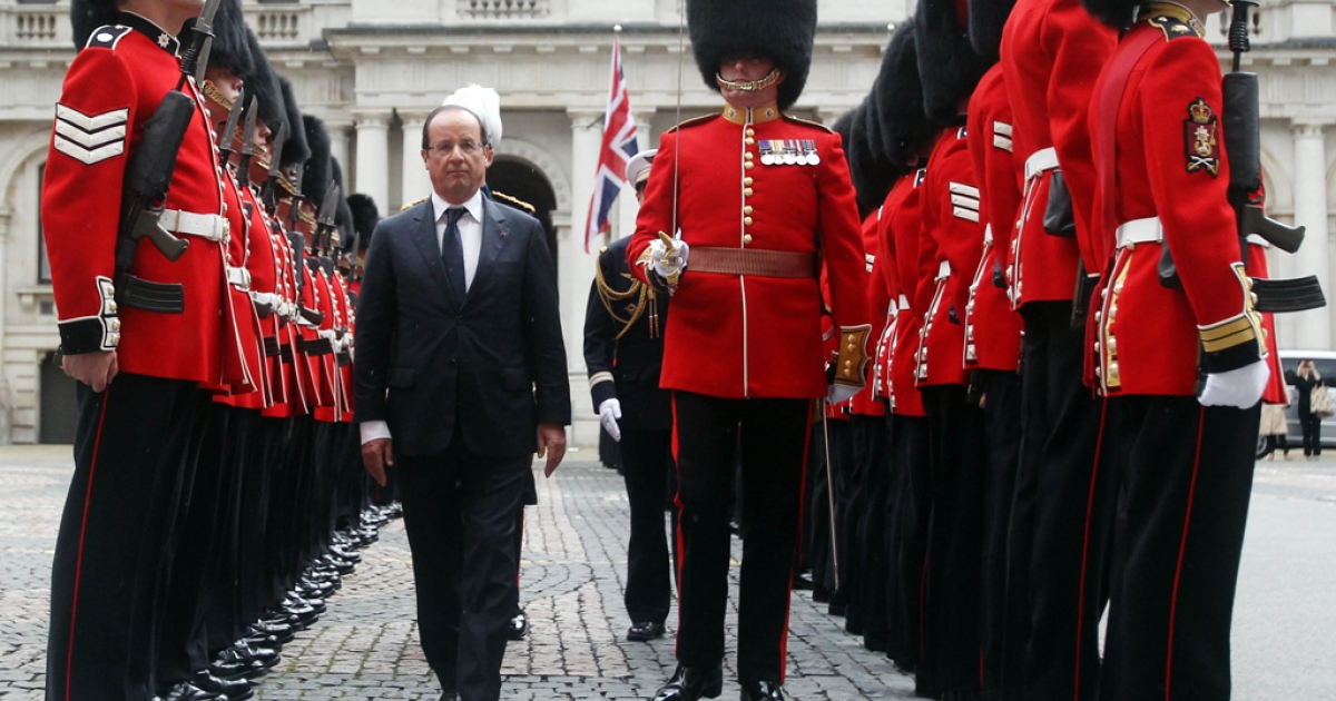 French President Francois Hollande inspects the guard of honor by the Coldstream Guards at the Foreign and Commonwealth Office on July 10, 2012 in London, England. This is the French President's first official visit to the United Kingdom since taking office, during which he will attend meetings with British Prime Minister David Cameron and Queen Elizabeth II.</p>
