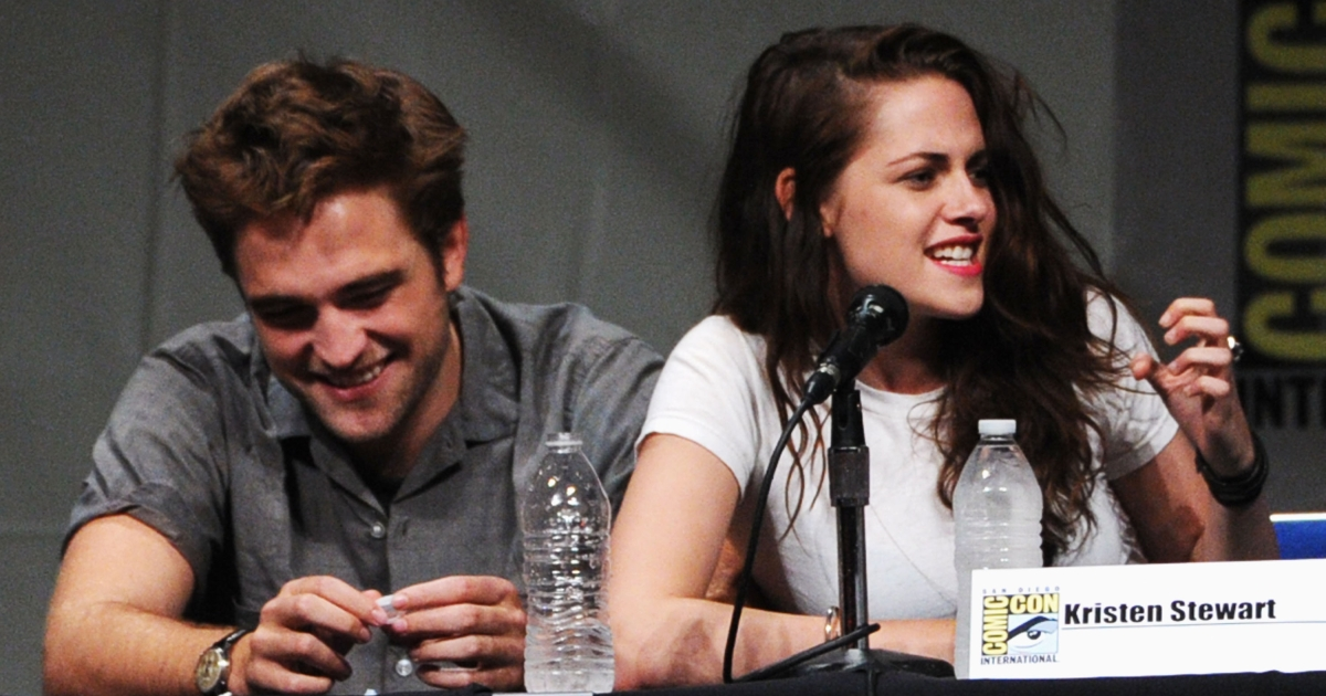 Actors Robert Pattinson (L) and Kristen Stewart speak at 'The Twilight Saga: Breaking Dawn Part 2' Panel during Comic-Con International 2012 at San Diego Convention Center on July 12, 2012 in San Diego, California.</p>