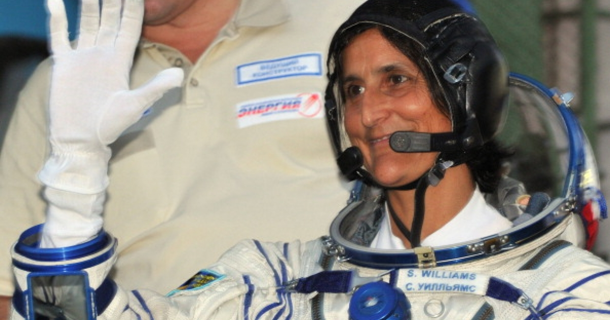 Astronaut Sunita Williams of the US gestures before boarding the Soyuz TMA-05M spacecraft at the Russian-leased Baikonur cosmodrome on July 15, 2012.</p>