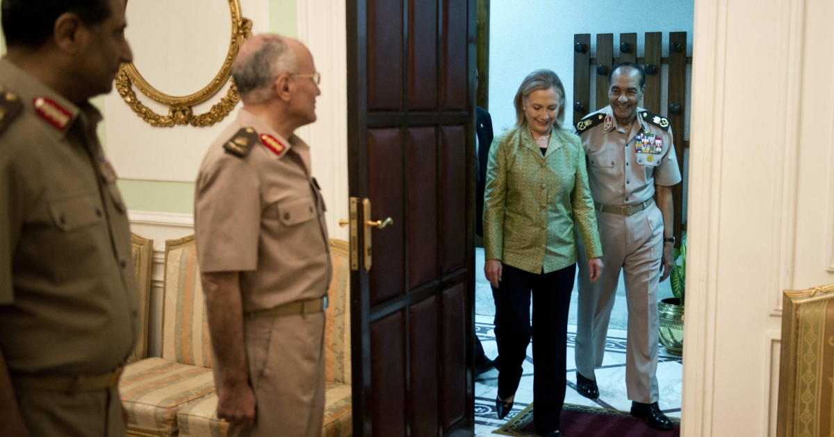 Field Marshal Mohamed Tantawi walks with US Secretary of State Hillary Clinton to a meeting at the Ministry of Defense on July 15, 2012 in Cairo, Egypt.</p>