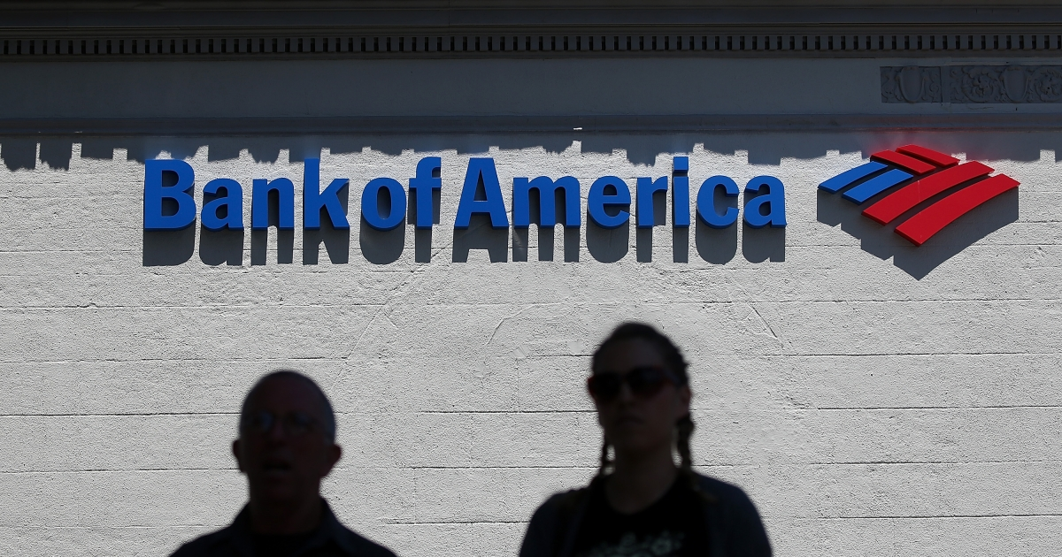 People walk by a Bank of America branch office on July 18, 2012 in San Anselmo, California.</p>