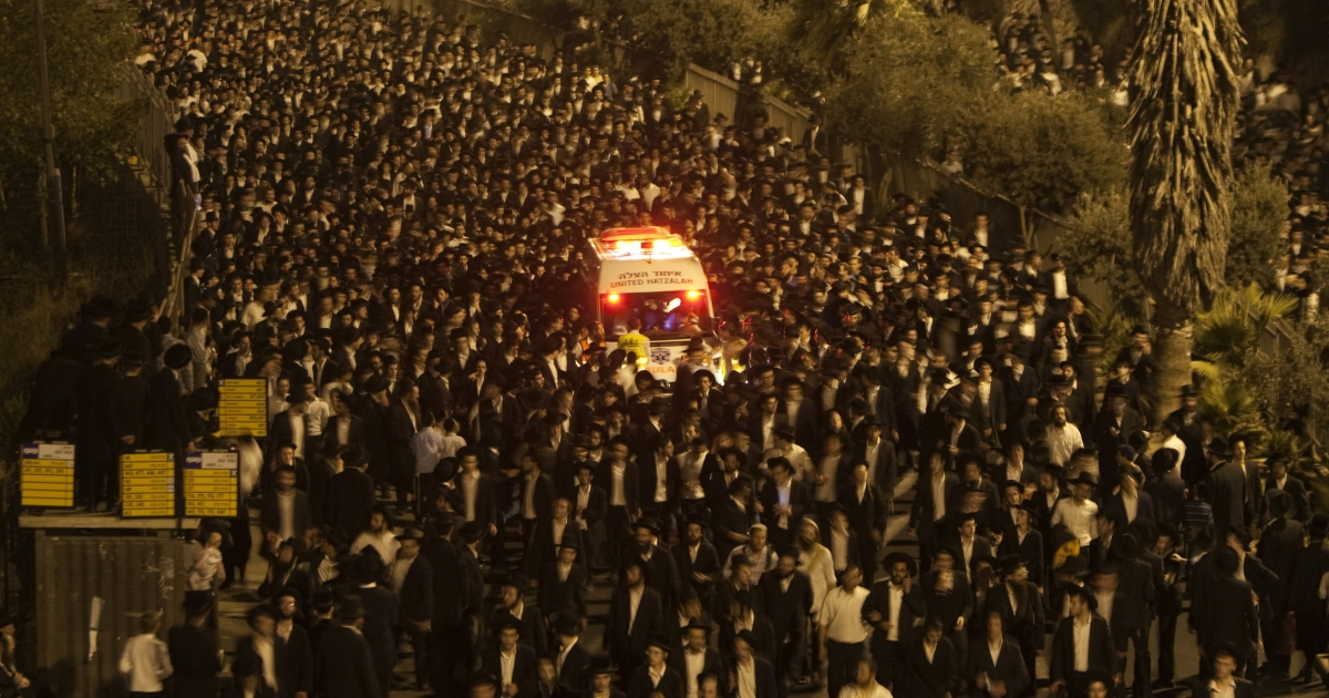 Ultra-Orthodox Jewish mourners of Rabbi Yosef Shalom Elyashiv attend his funeral procession in Jerusalem on July 19, 2012.</p>