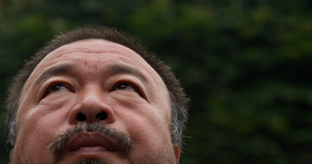 Chinese artist Ai Weiwei speaks to the media inside his compound in Beijing as the verdict of his court hearing is announced on July 20, 2012. Ai Weiwei lost his appeal against a multi-million-dollar tax fine on a company he founded, his lawyer said.</p>