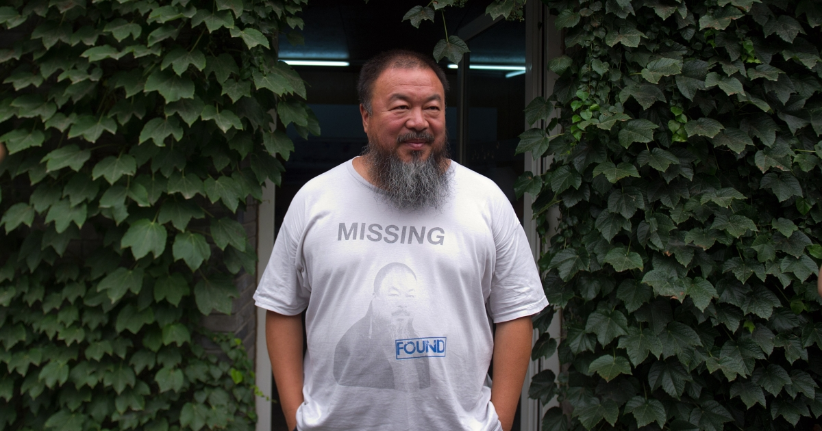 Chinese artist Ai Weiwei waits for his lawyer to return from a court hearing at his compound in Beijing on July 20, 2012.</p>