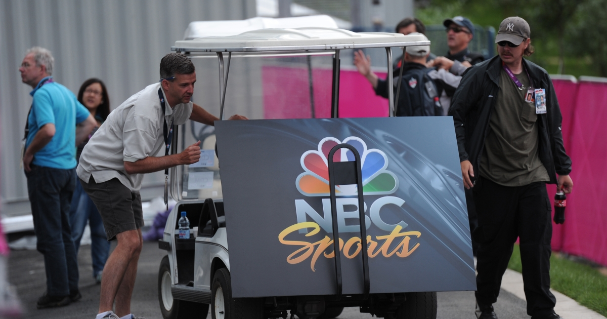 An NBC Sports poster board is unloaded from a buggy at the London 2012 Olympic Park, east London, on July 21, 2012. The London 2012 Olympic Games begin on July 27, 2012.</p>