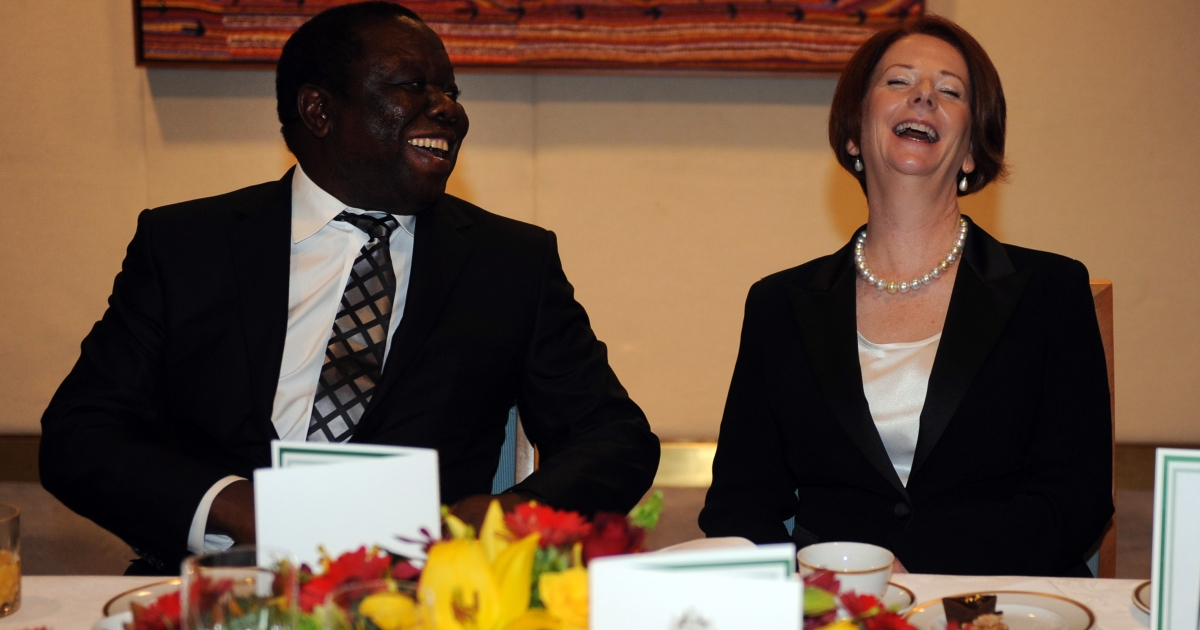 Australian Prime Minister Julia Gillard laughs with the Prime Minister of Zimbabwe Morgan Tsangviri during a lunch in Canberra, Monday, July 23, 2012.</p>