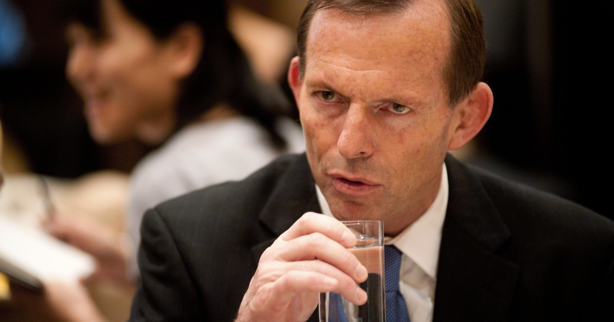 Australian opposition leader Tony Abbott listens to his guests at a breakfast meeting hosted by the China-Australia Chamber of Commerce in Beijing on July 24, 2012.</p>