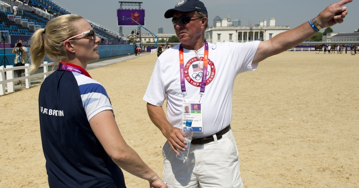 Britain's eventing individual champion and granddaughter of Queen Elizabeth II, Zara Phillips (L) chats with her father and coach of the US eventing team, Mark Phillips at the Equestrian arena in Greenwich, London, on July 25, 2012, two days before the start of the London 2012 Olympic Games.</p>