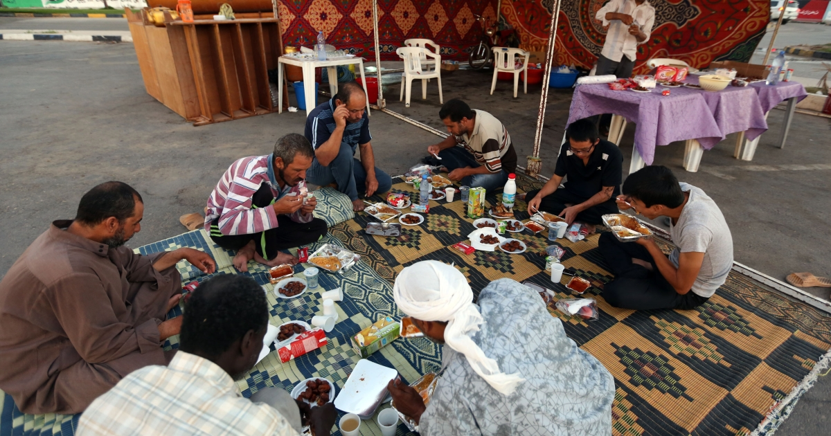Libyans break their fast at the end of the sixth day of Islam's holy month of Ramadan, in Tripoli, on July 25, 2012.</p>