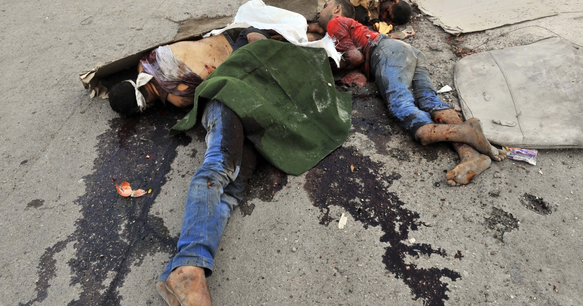 GRAPHIC CONTENT: The bodies of men killed during clashes between Syrian rebel fighters and government forces are seen lying on the road in Syria's restive northern city of Aleppo on July 26, 2012.</p>