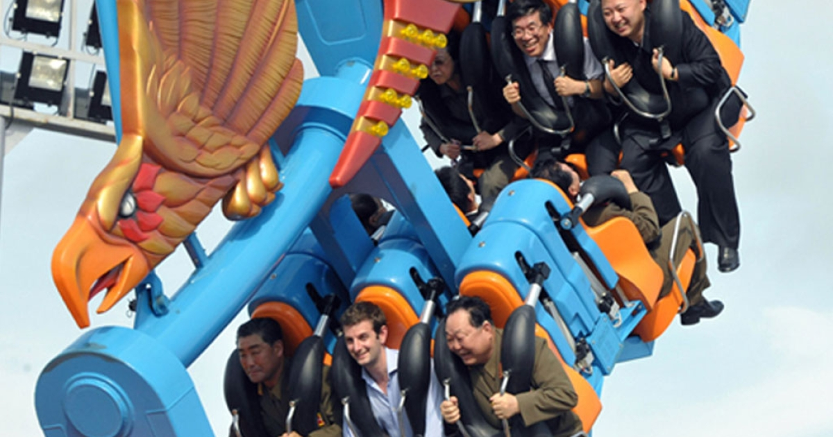 This undated picture released by the Korean Central News Agency (KCNA) via Korea News Service (KNS) on July 27, 2012, shows North Korean leader Kim Jong-Un, back row right, enjoying a ride at the Rungna People's Pleasure Ground in Pyongyang. In the front row, center, is British embassy staffer Barnaby Jones.</p>