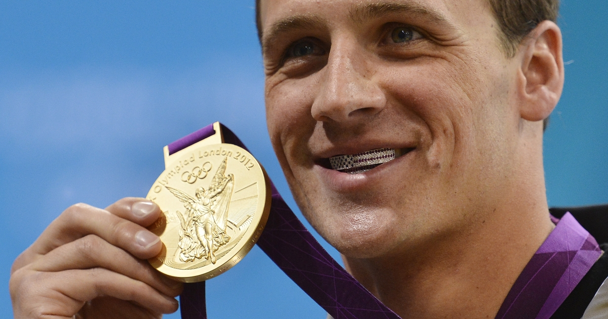 Ryan Lochte initially wearing his grill, before IOC members asked him to remove it.</p>