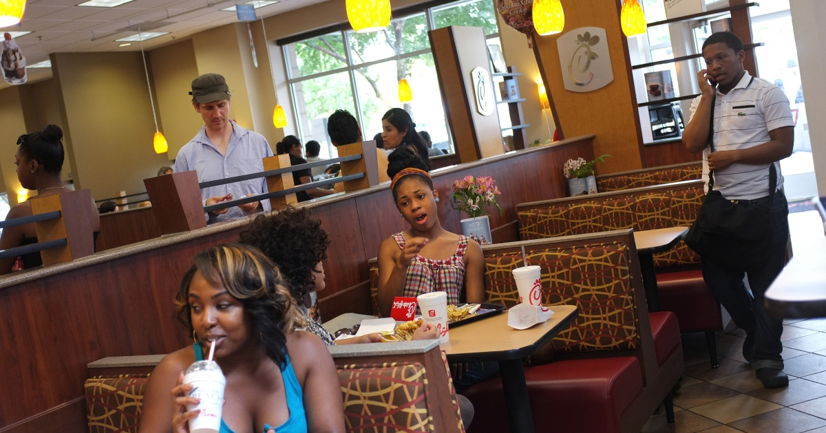 Patrons are seen inside a Chick-fil-A restaurant on July 28, 2012 in Bethesda, Maryland.</p>