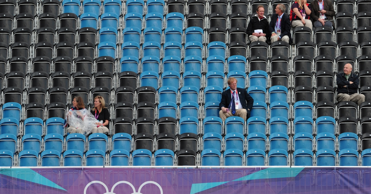 Empty seats and spectators are pictured during in the dressage event of the equestrian eventing competition at the London 2012 Olympic Games in Greenwich Park, London, on July 29, 2012.</p>