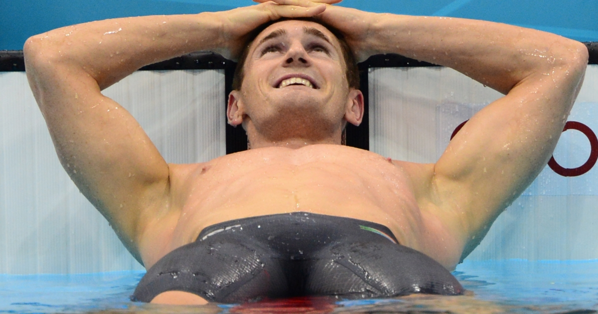 South Africa's Cameron Van der Burgh celebrates after breaking the world record the men's 100m breaststroke final swimming event at the London 2012 Olympic Games on July 29, 2012 in London.</p>