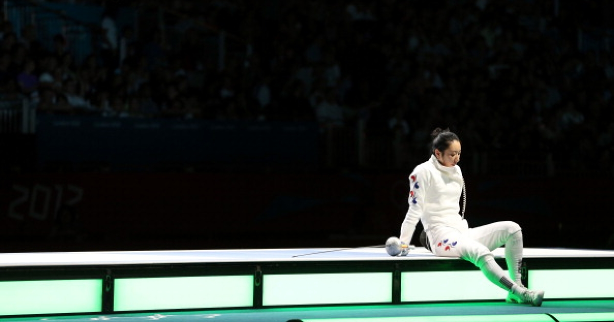 A Lam Shin of Korea sits and waits to hear the outcome of an appeal to overturn the judges ruling on an issue of a delayed clock that caused her to loss her bout against Britta Heidemann of Germany during the Women's Epee Individual Fencing Semifinals on Day 3 of the London 2012 Olympic Games at ExCeL on July 30, 2012 in London, England.</p>