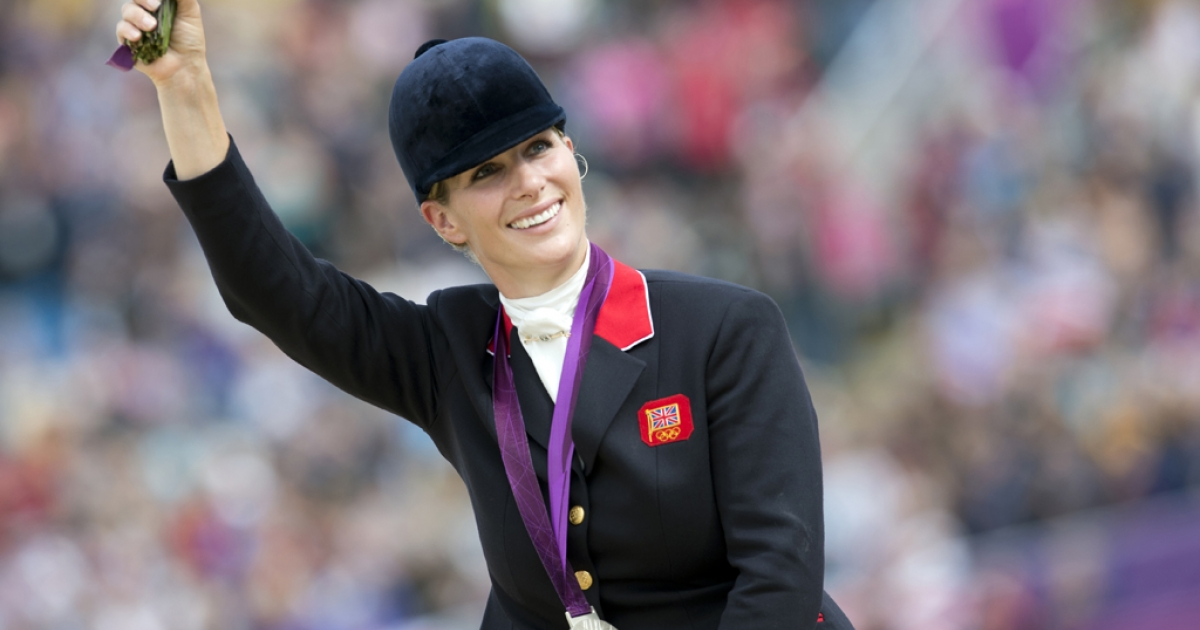 Britain's Zara Phillips waves to the crowd after winning the silver medal in the team Equestrian section of the Eventing competition of the 2012 London Olympics at the Equestrian venue in Greenwich Park, London on July 31, 2012.</p>