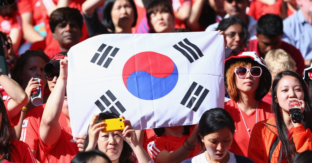 The International Olympic Committee urged South Korea to bar a footballer from the bronze medal ceremony Saturday after he flashed a political message on the field.</p>