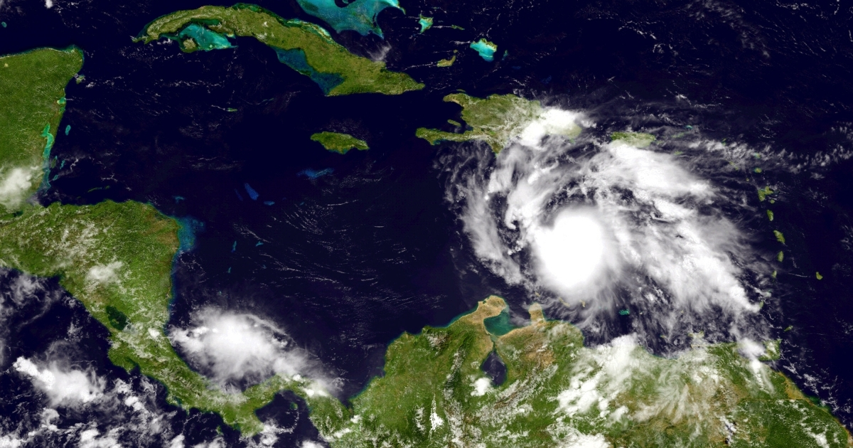 A handout photo provided by the National Oceanic and Atmospheric Administration (NOAA) shows Tropical Storm Ernesto building strength as it moves west toward Jamaica Aug. 4 in the Caribbean.</p>