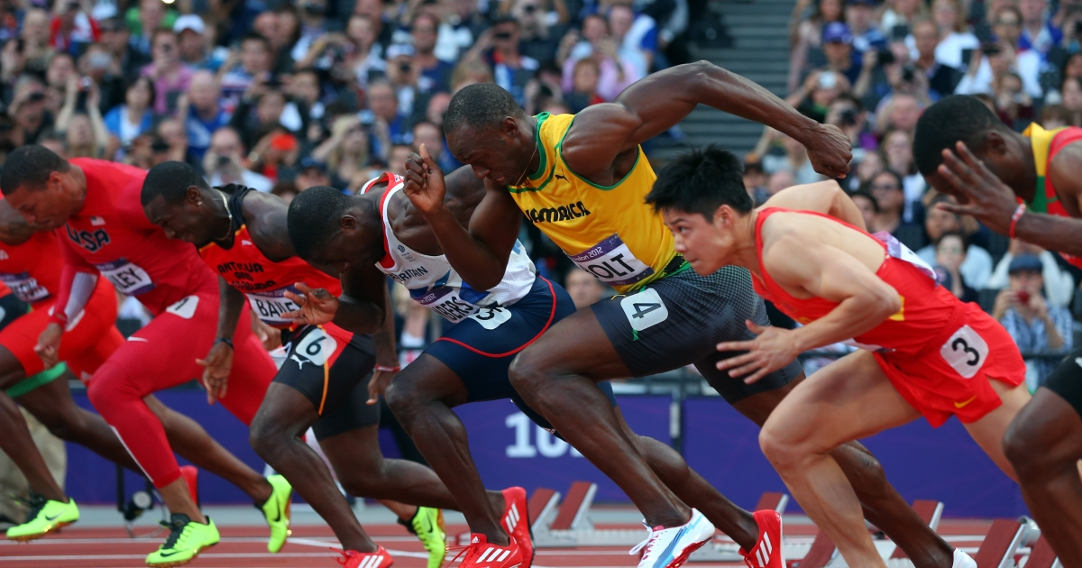 Usain Bolt of Jamaica competes in the Men's 100m Final on Day 9 of the London 2012 Olympic Games at the Olympic Stadium on August 5, 2012 in London, England.</p>