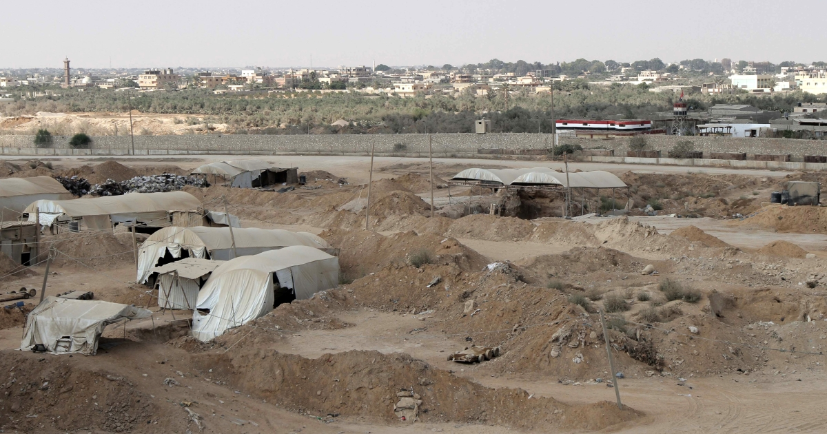 Tents cover entrances of tunnels used for smuggling along the Gaza-Egypt border, near the southern Gaza Strip town of Rafah on August 06, 2012.</p>