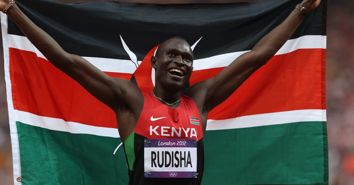 David Lekuta Rudisha of Kenya celebrates with his country's national flag after winning gold and setting a new world record of 1.40.91 in the Men's 800m.</p>