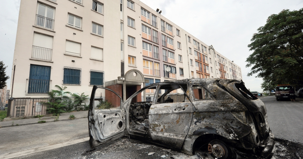 A picture taken on August 14, 20102 shows a burnt car in Amiens, northern France. A riot in a deprived area of Amiens has left 16 police officers injured, a primary school severely damaged by fire and a sports centre completely destroyed.</p>