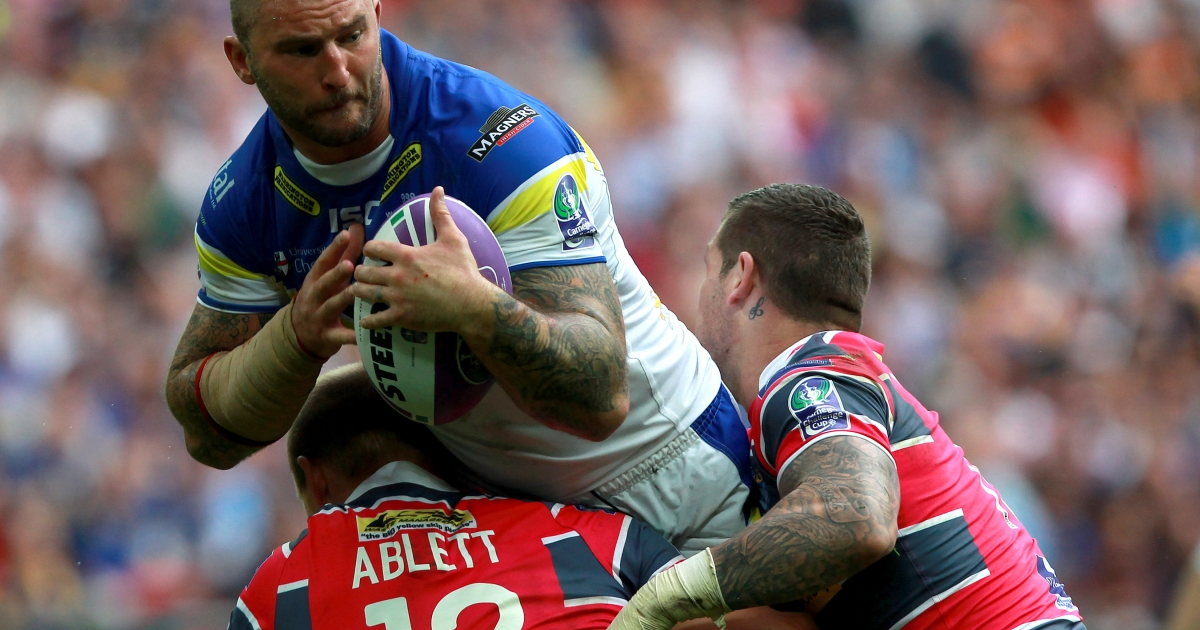 Paul Wood of Warrington Wolves offloads in the tackle from Carl Ablett of Leeds Rhinos during the Carnegie Challenge Cup Final between Leeds Rhinos and Warrington Wolves at Wembley Stadium on August 25, 2012 in London, England.</p>