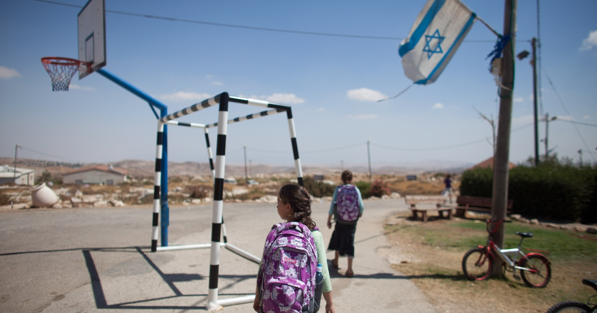 Jewish settler children return home from school at the settlement outpost of Migron on Aug. 28, 2012 in the West Bank.</p>