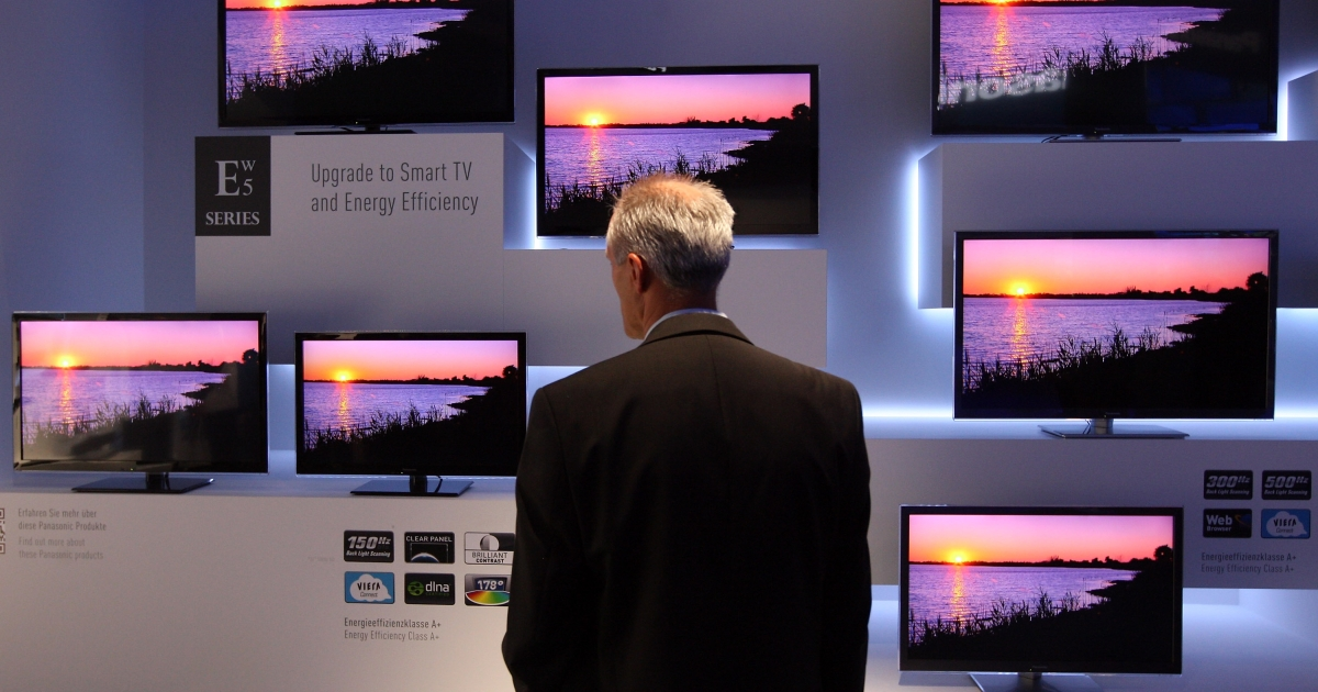 A visitor to the Internationale Funkausstellung (IFA) 2012 consumer electronics trade fair in Berlin, Germany looks at the Panasonic ETW5 energy efficient Smart TV flat-screen televisions.</p>
