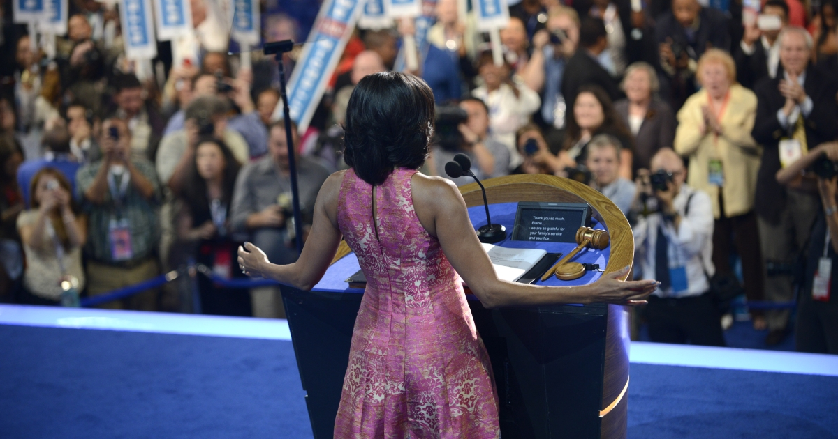 First Lady Michelle Obama acknowledges the audience at the Time Warner Cable Arena in Charlotte, North Carolina, on September 4, 2012 on the first day of the Democratic National Convention (DNC).</p>