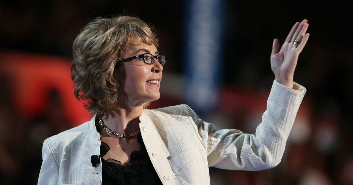 Former U.S. Rep. Gabrielle Giffords (D-NV) walks on stage during the final day of the Democratic National Convention at Time Warner Cable Arena on September 6, 2012 in Charlotte, North Carolina.</p>