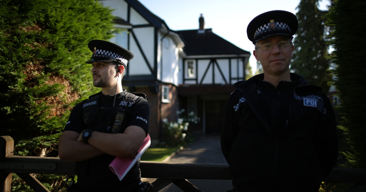 Police stand outside a house believed to belong to the al-Hilli family on September 7, 2012 in Claygate, England.</p>
