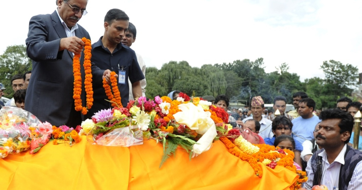 Unified Communist Party of Nepal (Maoist) chairman, Pushpa Kamal Dahal (R), also known as 'Prachanda' pays respects to controversial politician Ramraja Prasad Singh in Kathmandu on September 12, 2012.</p>