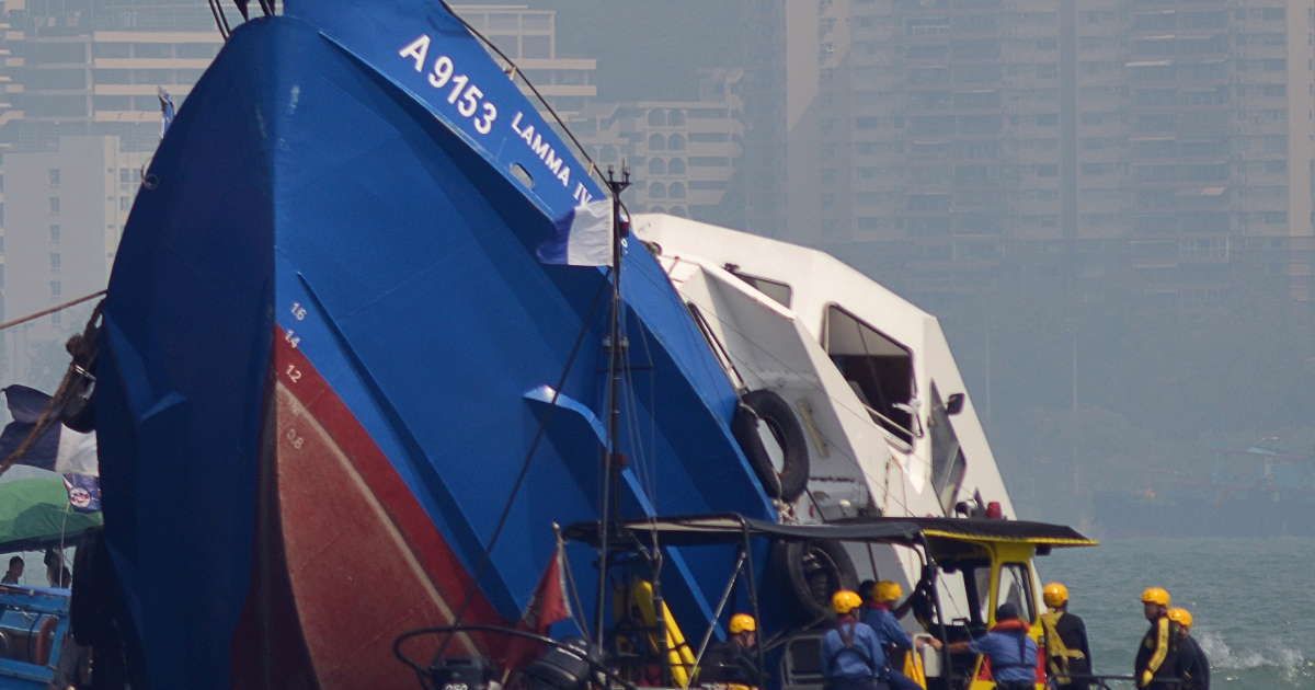 The bow of the Lamma IV boat (L) is seen partially submerged during rescue operations on October 2, 2012 the morning after it collided with a Hong Kong ferry killing over 30 people.</p>