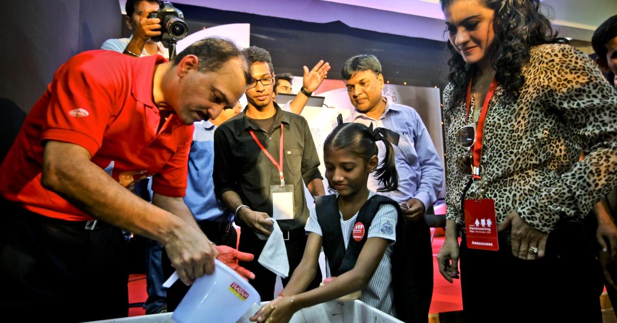 MUMBAI, INDIA - OCTOBER 15: CEO &amp; MD of Unilever India, Nitin Paranjpe (L) and Bollywood movie actress, Kajol (R) attend a Global Handwashing Day event at Worli Seaface Mumbai Municipal Corporation School on October 15, 2012 in Mumbai, India.</p>