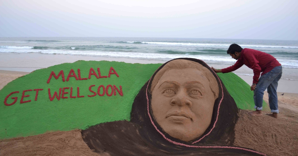 Indian sand artist Sudarsan Pattnaik gives final touches on a sand sculpture in honour of Pakistani girl Malala Yousufzai at Puri beach, some 65 kilometers from Bhubaneswar, on October 16, 2012.</p>