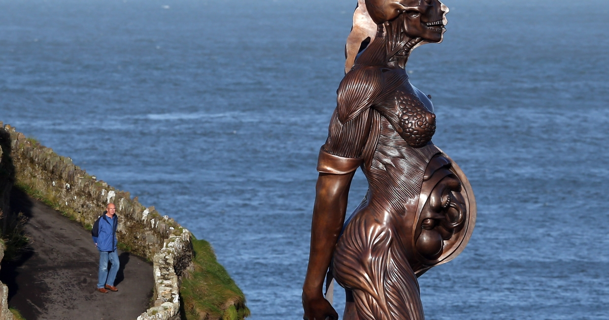 The morning sun illuminates detail in Damien Hirst's bronze sculpture of a pregnant woman on October 17, 2012 in Ilfracombe, England.</p>