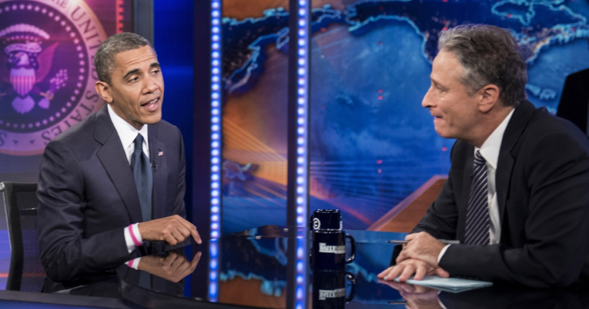 US President Barack Obama and host Jon Stewart speak during a live taping of