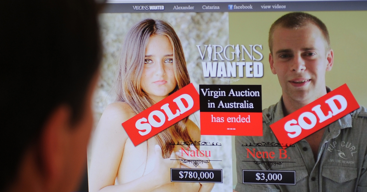 This photo illustration shows a man (L) looking at the 'Virgins Wanted' website in Sydney on October 25, 2012. Brazilian student Catarina Migliorini (C) and Sydney student Alex Stepanov (R) sold their viginity in an online auction as part of a documentary organised by Australian filmmaker Jason Sisely.</p>