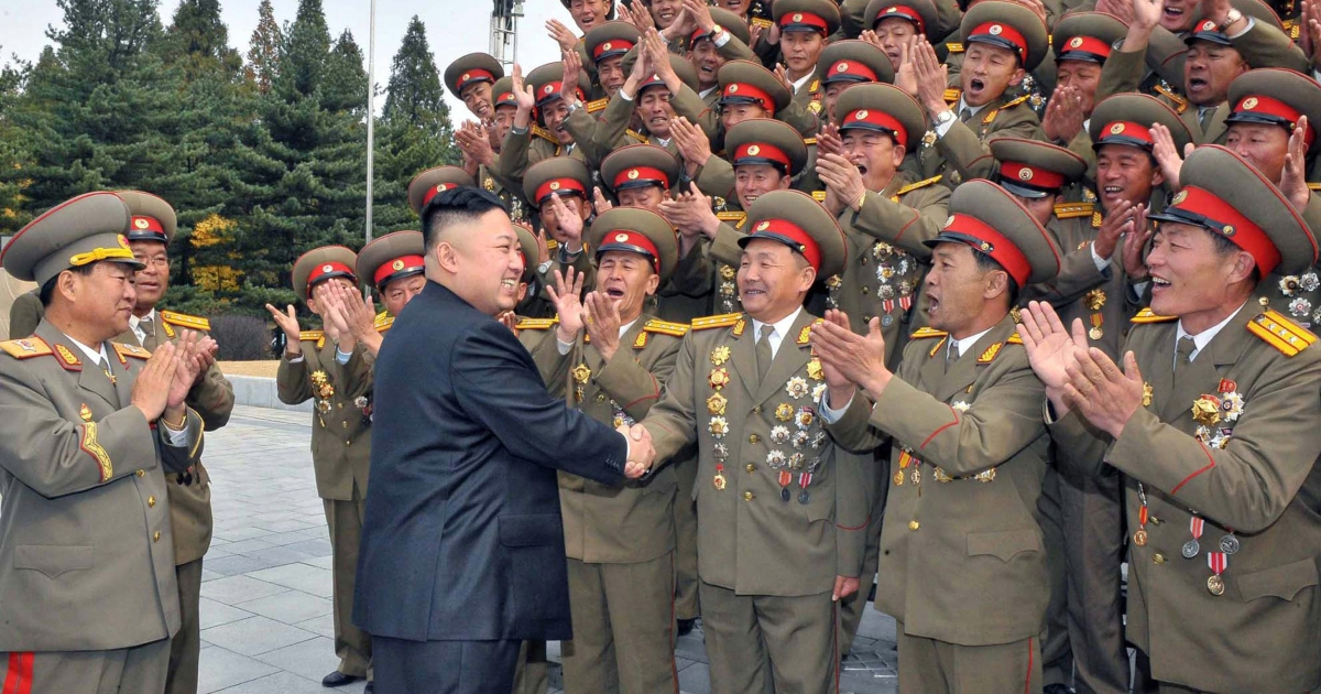 This picture, taken by North Korea's official Korean Central News Agency on October 29, 2012 shows North Korean leader Kim Jong Un (2nd L) being greeted at the 60th anniversary of the Kim Il Sung Military University.</p>