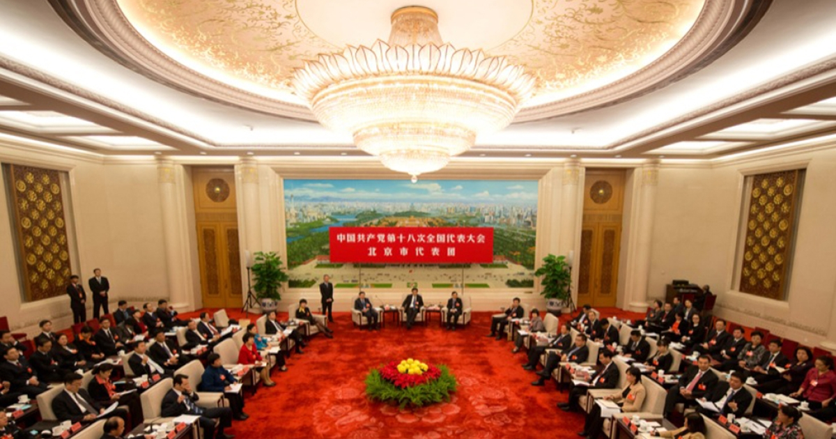 Delegates from Beijing hold a meeting in the Beijing room at the Great Hall of the People in Beijing on November 9, 2012.</p>