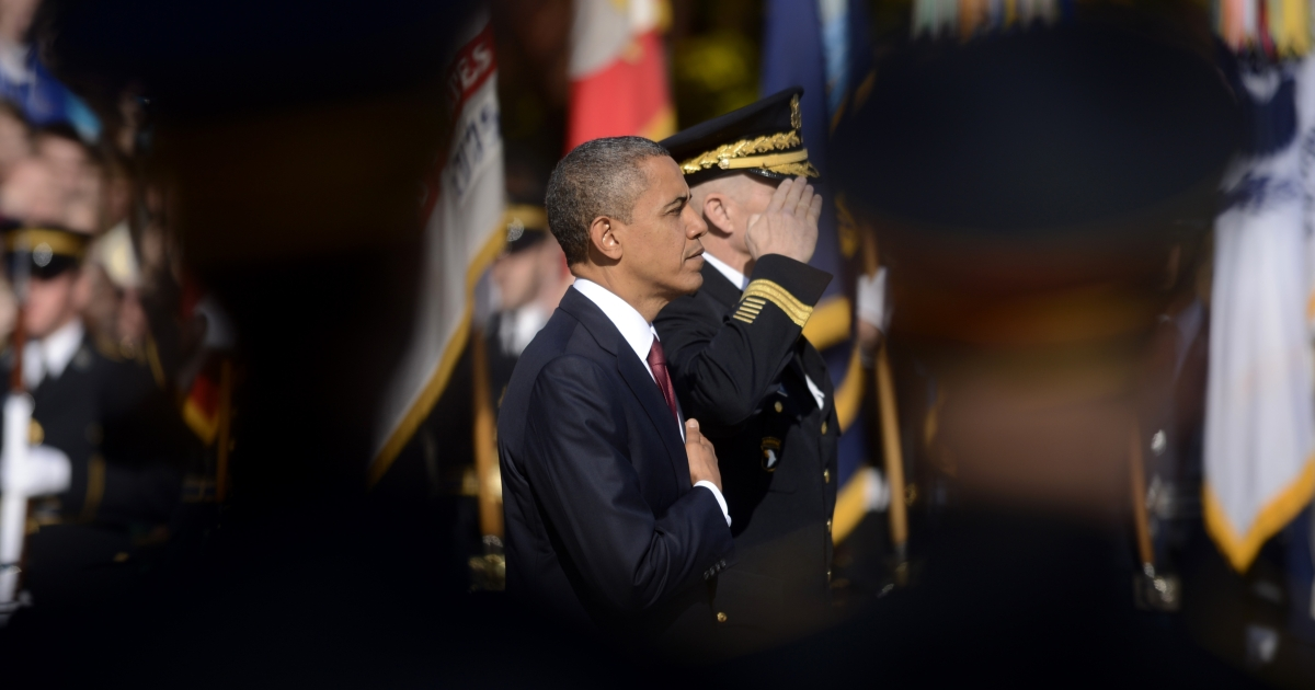 President Barack Obama and senior military officers participate in a wreath-laying ceremony on Veteran's Day at the Tomb of the Unknown Soldier in Arlington National Cemetery on November 11, 2012 in Arlington, Virginia.</p>
