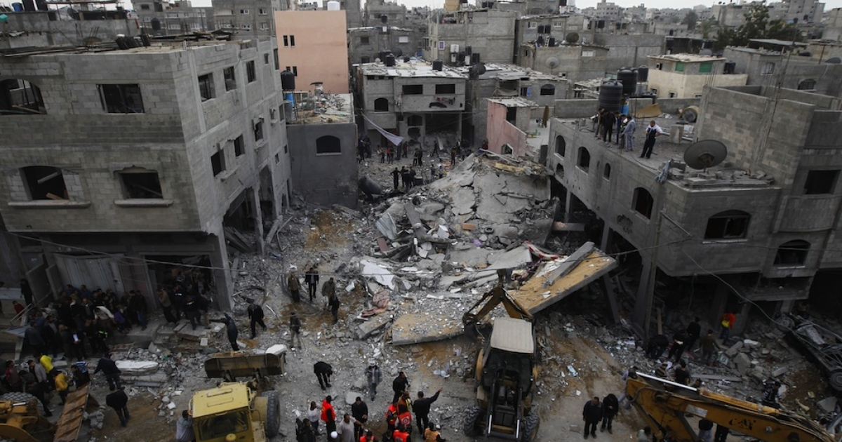 Palestinians gather at the site of an Israeli air raid in Gaza City on November 17, 2012.</p>